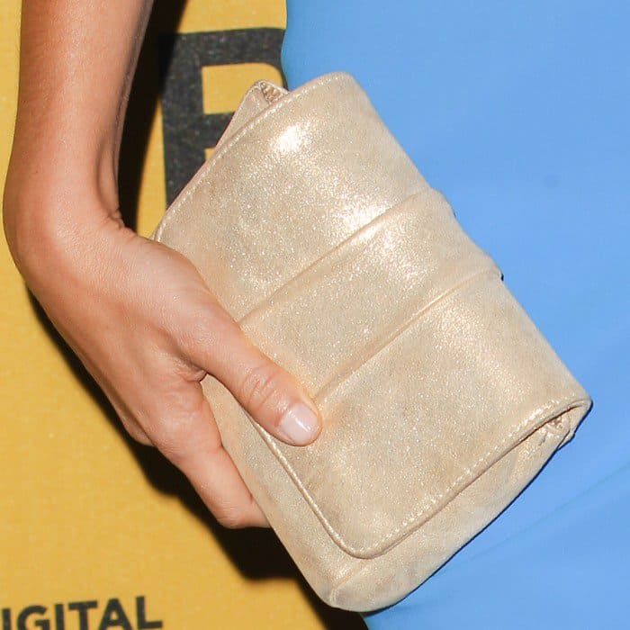 Arielle Kebbel carrying a clutch at the 2014 Crystal + Lucy Awards
