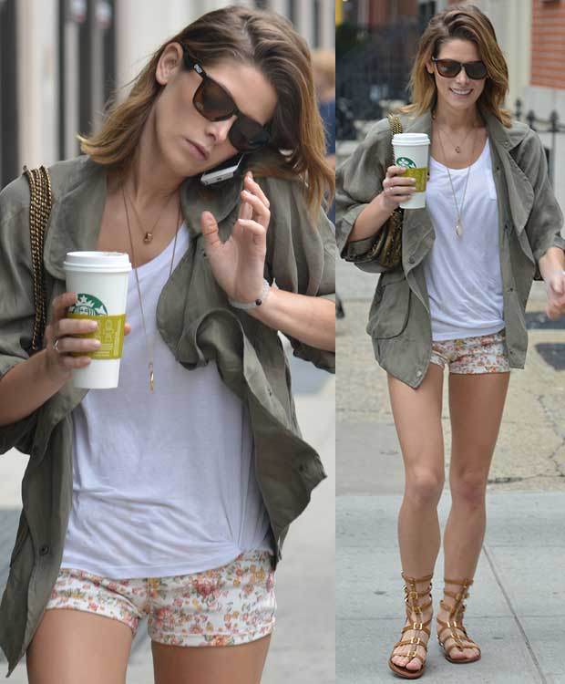 Ashley Greene wears a white tee, floral shorts, and a jacket
