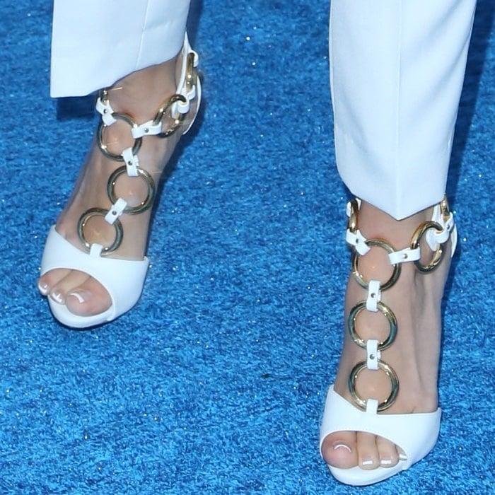 Ashley's lovely ring-detailed sandals are from Giuseppe Zanotti