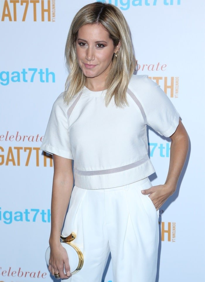 Ashley Tisdale wearing a short-sleeved cropped top