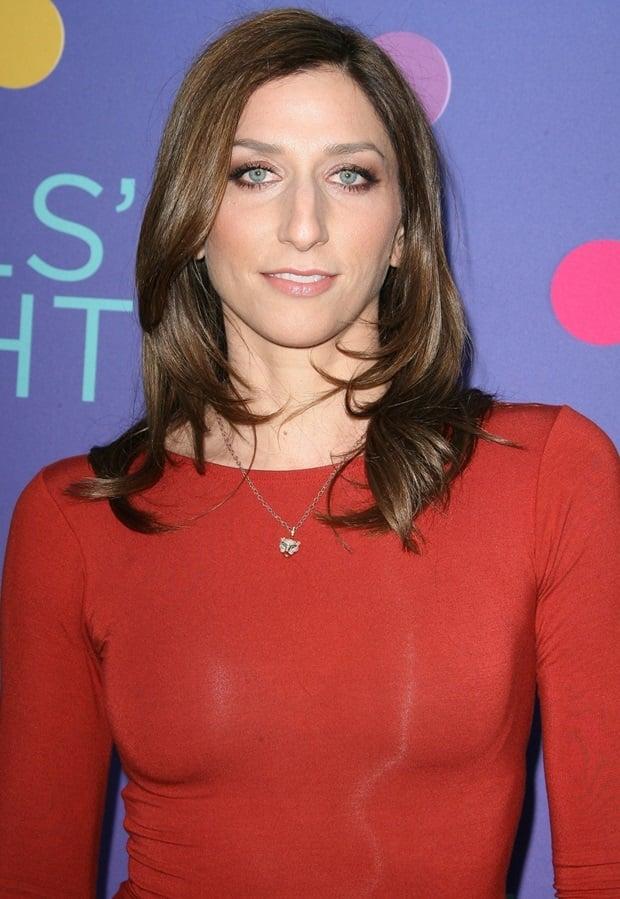 Chelsea Peretti wearing a sleek red dress