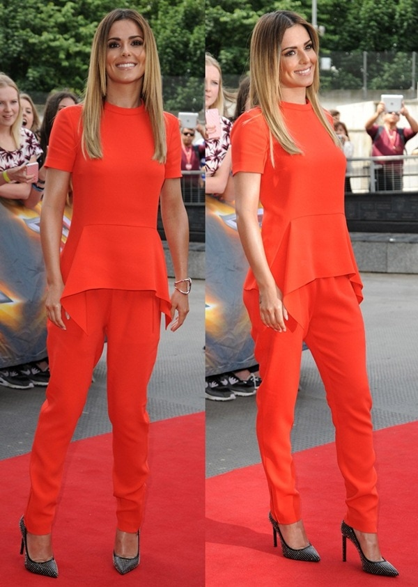 Cheryl Cole in a bright red-orange jumpsuit by Stella McCartney