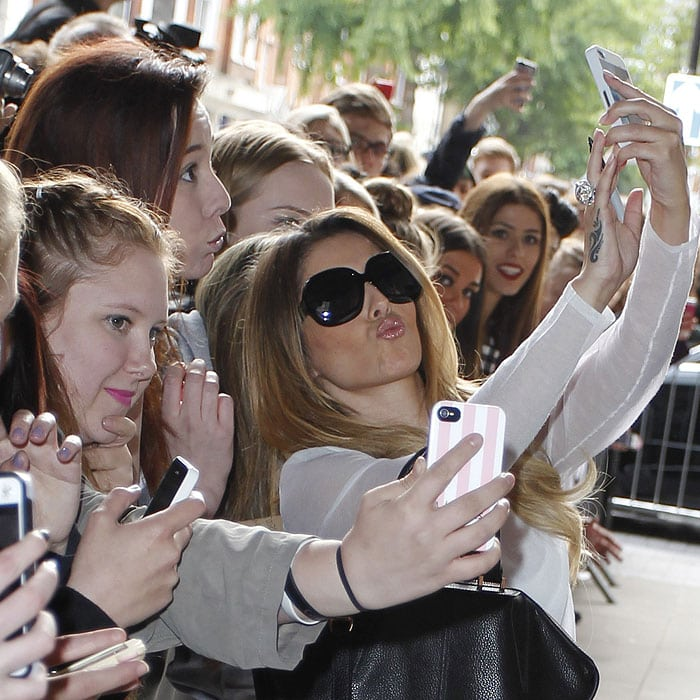 Cheryl Cole and a fan making duck faces
