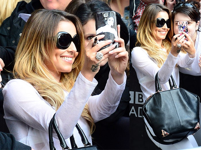 Cheryl Cole taking selfies with fans outside the BBC Radio 1 studios in London, England, on June 2, 2014