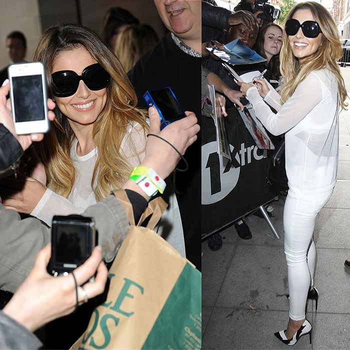 Cheryl Cole being surrounded by fans and the paparazzi