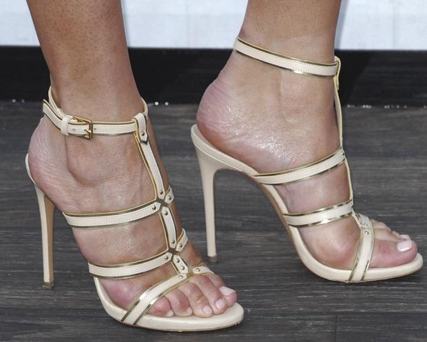 Chrissy Teigen wearing a lovely pair of gladiator stiletto sandals by Casadei