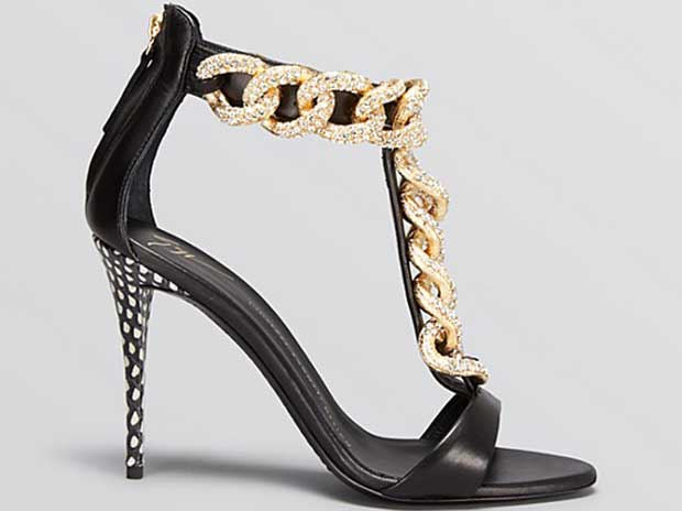 Theirt-straps havegold-tone chunky chain details studded with sparkling Swarovski crystals, which make them hard to ignore