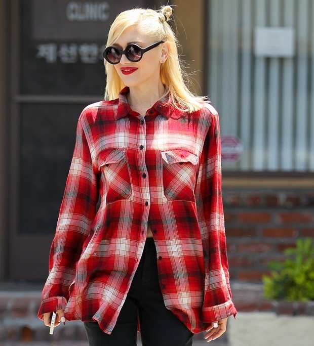 Gwen Stefani in an oversized red checked shirt visiting Jesun Acupuncture Clinic