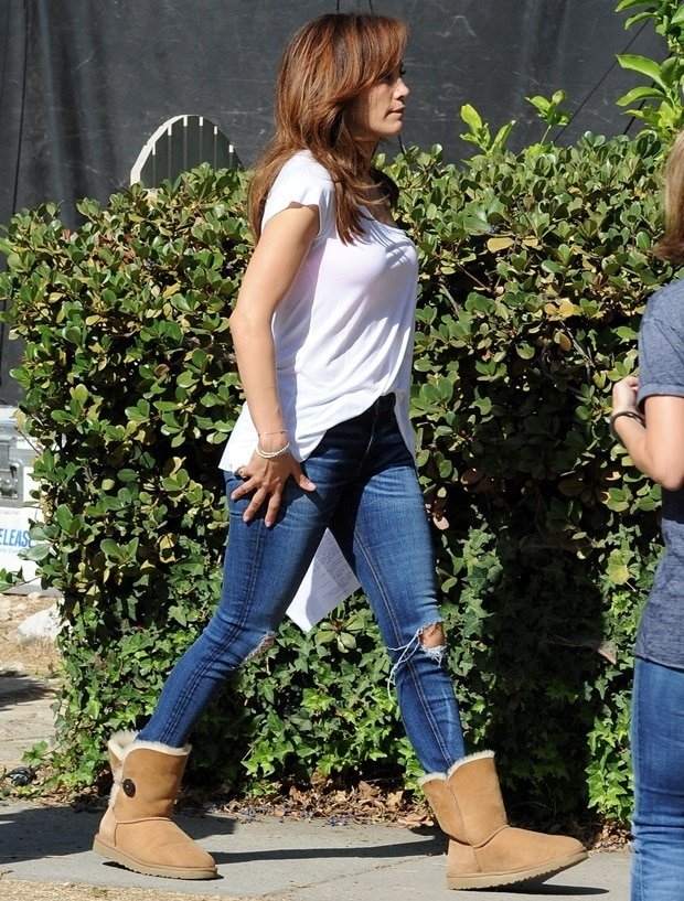 Jennifer Lopez rocks classic blue jeans with a white top and ugg boots