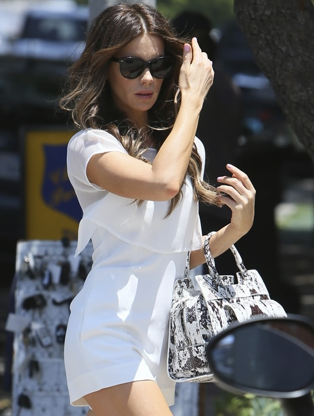 Kate Beckinsale in a white spaghetti strap romper by L'Agence