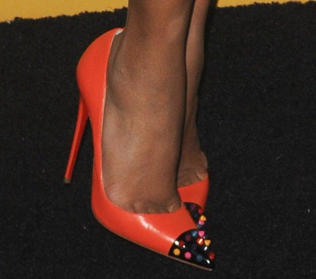 "Kerry Washington wearing orange studded Christian Louboutin ""Geo"" pumps"