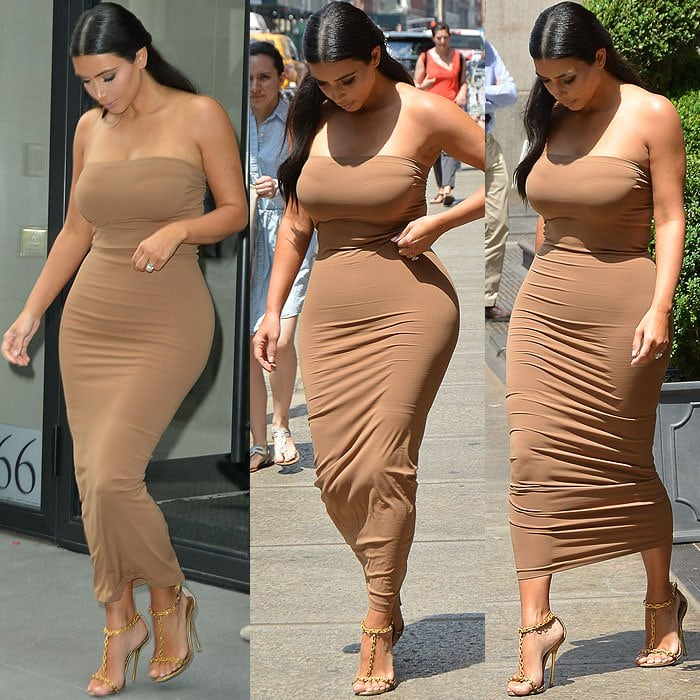 Kim Kardashian constantly checking her appearance and adjusting the shapewear underneath her dress