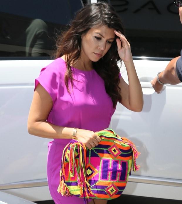 Kim Kardashian Kourtney Kardashian and Khloe Kardashian film scenes for their reality show Keeping Up With The Kardashians.