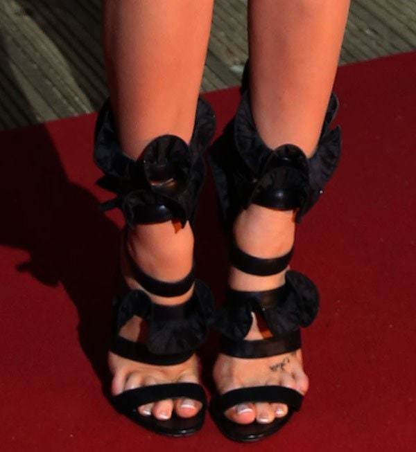 Laura Whitmore showing off her feet in Emanuel Ungaro Wrap-around ruffled leather sandals