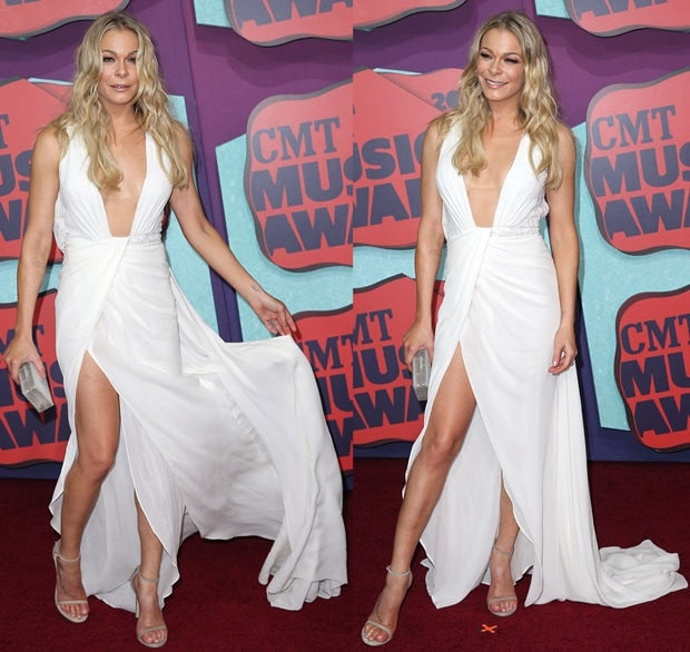 Leann Rimes donned a low-cut silk gown from the Rani Zakhem Spring 2014 collection that showed off her legs and cleavage