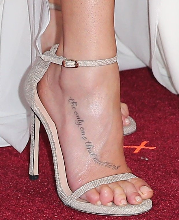 LeAnn Rimes showing off her foot tattoo with the words 'The only one that matters'