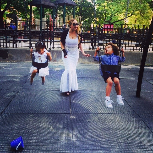 Mariah Carey pushing her fraternal twins, Monroe and Moroccan Scott, on the swings at a park in Manhattan