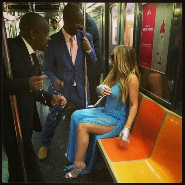 Mariah Carey with two suited gentlemen on the New York subway – posted on Instagram on May 30, 2014