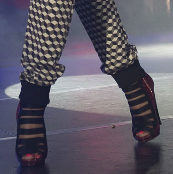 Nicki's Gucci sandals are fashioned out of red python snake material