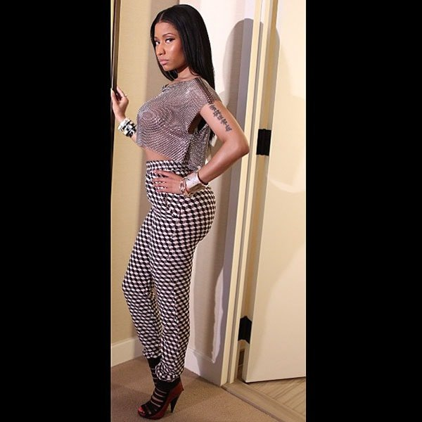 Nicki Minaj wearing a Fannie Schiavoni top and Manish Arora python pants