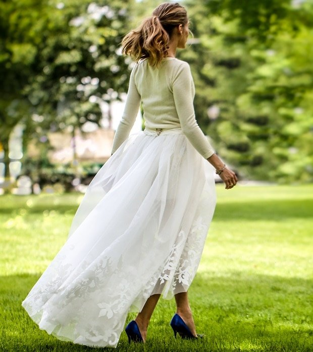 Olivia Palermo's wedding dress consisted of a long-sleeve cashmere sweater and white shorts with a full tulle skirt overlay