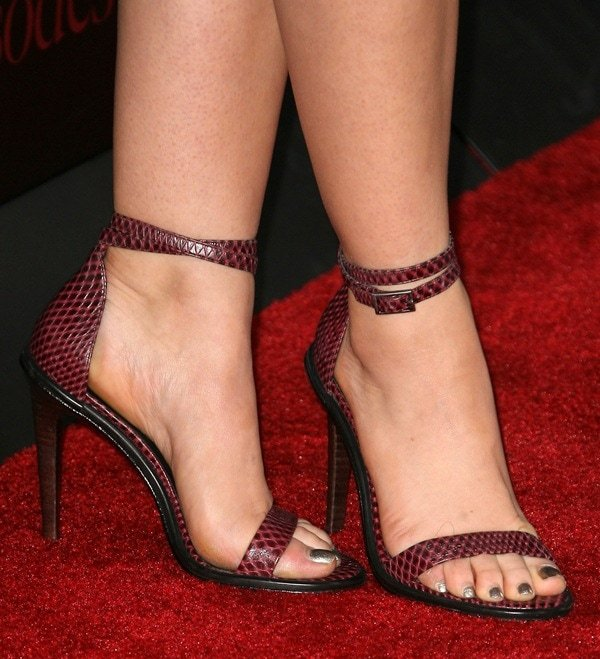 Lucy Hale wearing wine-colored ankle-strap sandals