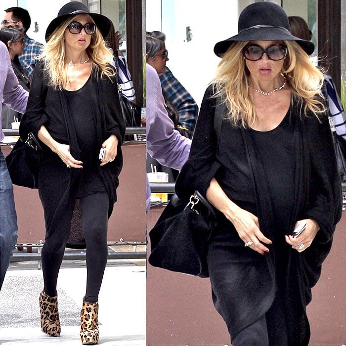 There seems to be no way Rachel Zoe will ever give up wearing heels