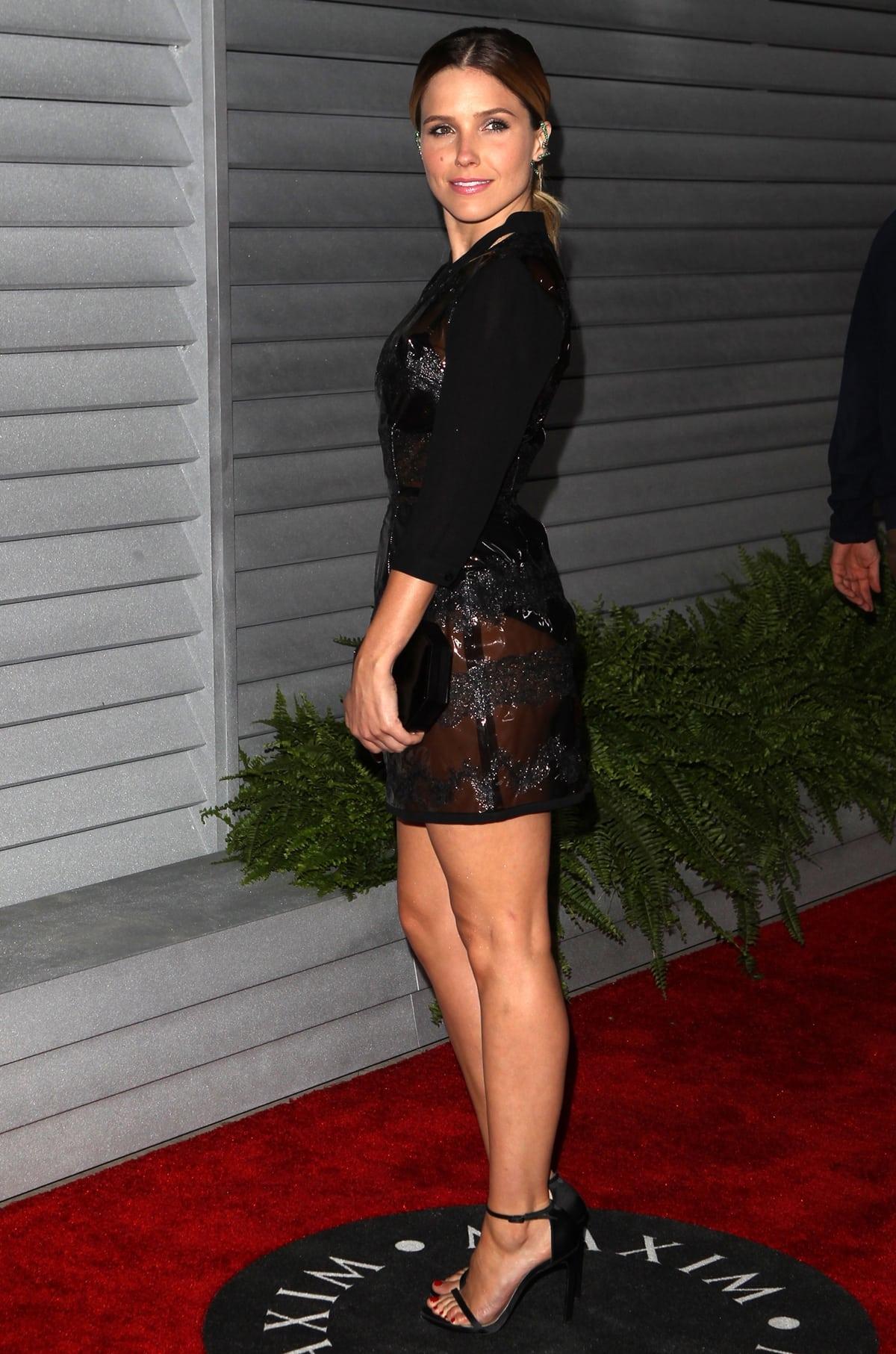 Sophia Bush displays her hot legs in a sexy Fleur du Mal dress