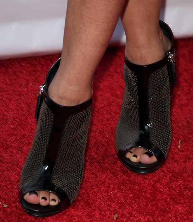 Tonya Lewis Lee wearing a pair of booties