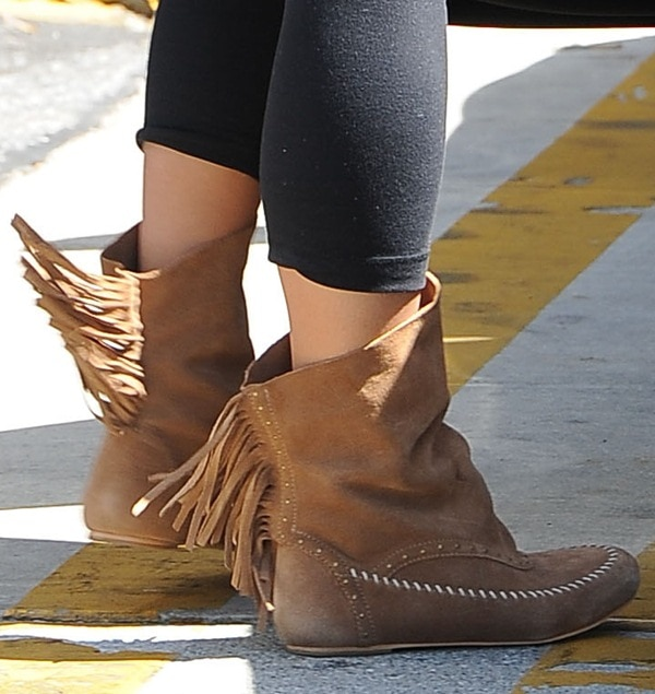 Vanessa Hudgens inKoolaburra Becca boots with fringe details and a slouchy look