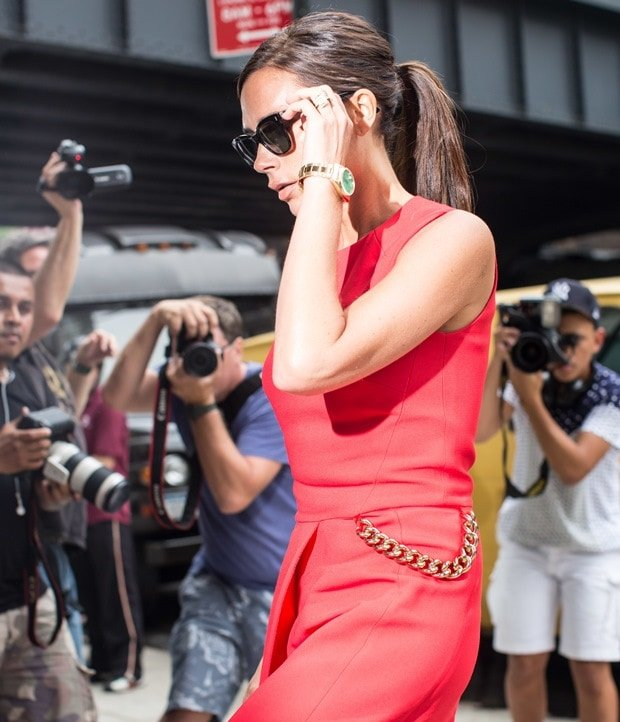 Victoria Beckham styled the statement dress with oversized sunglasses