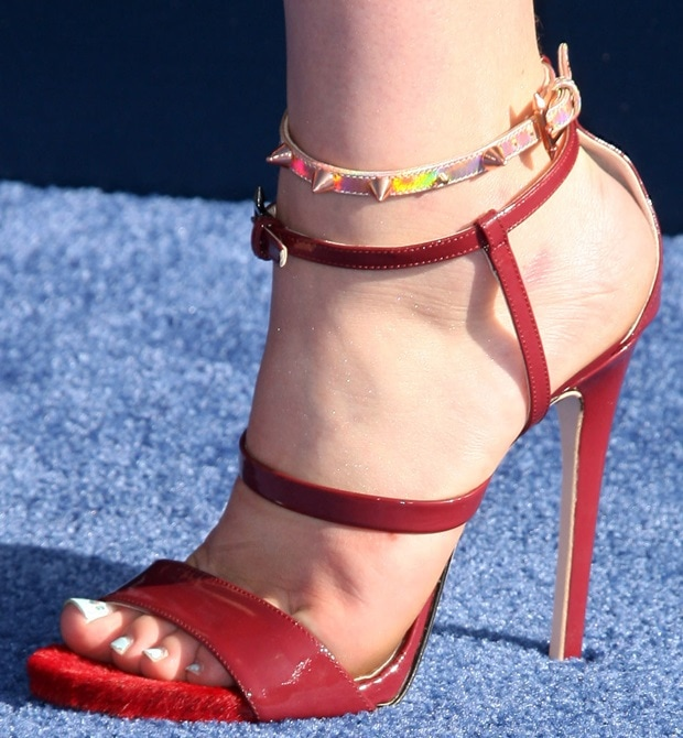 Willow Shields's feet in 'Rae' sandals with pony-hair-covered toes