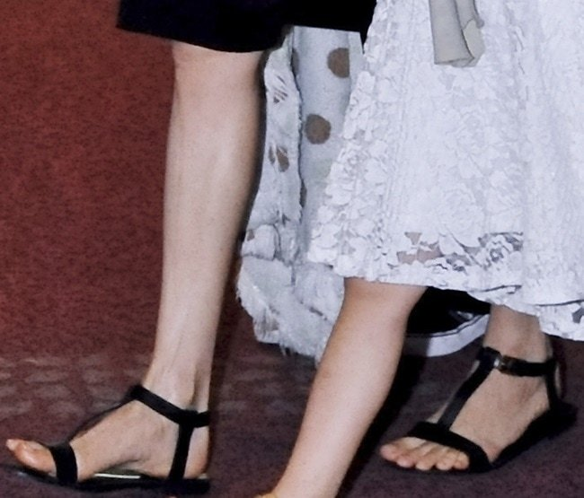 Angelina Jolie's feet in flat t-strap sandals