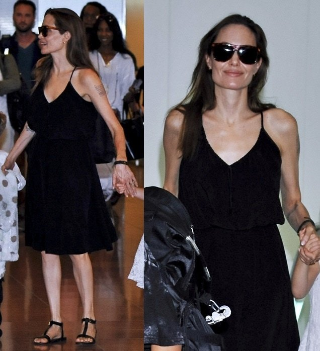 Angelina Jolie flaunted her legs in a black tank dress