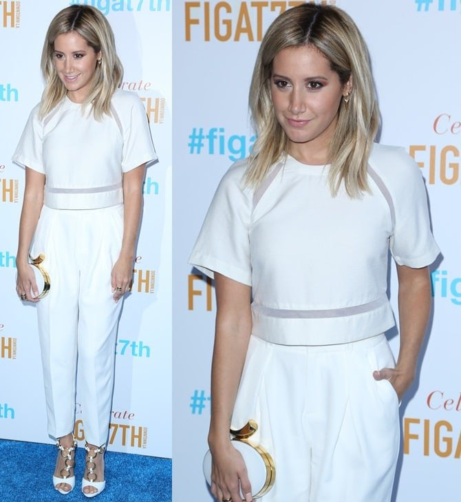 Ashley wore all-white separates consisting of a short-sleeved cropped top and high-waist trousers