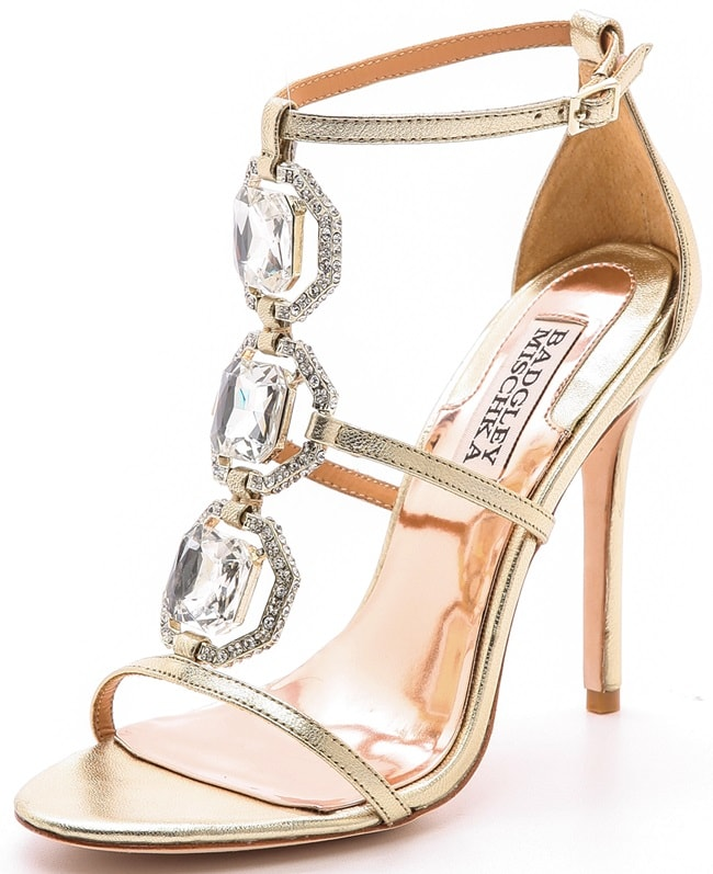 Pavé crystal bands frame striking rhinestones on delicate, metallic leather Badgley Mischka sandals
