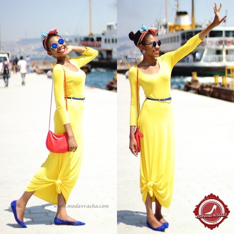Onyinye of Modavracha's Spot capping off her yellow maxi frock with cute pointy flats to polish up her look
