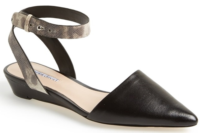 A stunning pointy-toe flat with a snakeskin-embossed wraparound ankle strap is both casual and chic, making it a natural choice for both work and play