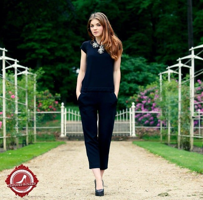 Suzanne of 'Fashion Is a Party' in all-black separates styled with black platform pumps and a statement necklace