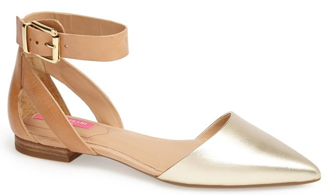 A contrasting point toe modernizes a sleek leather flat styled with a buckle-detailed ankle strap.