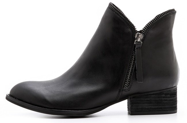 Open zipper trim lends sculptural appeal to sturdy leather Jeffrey Campbell booties, styled with a structured almond toe
