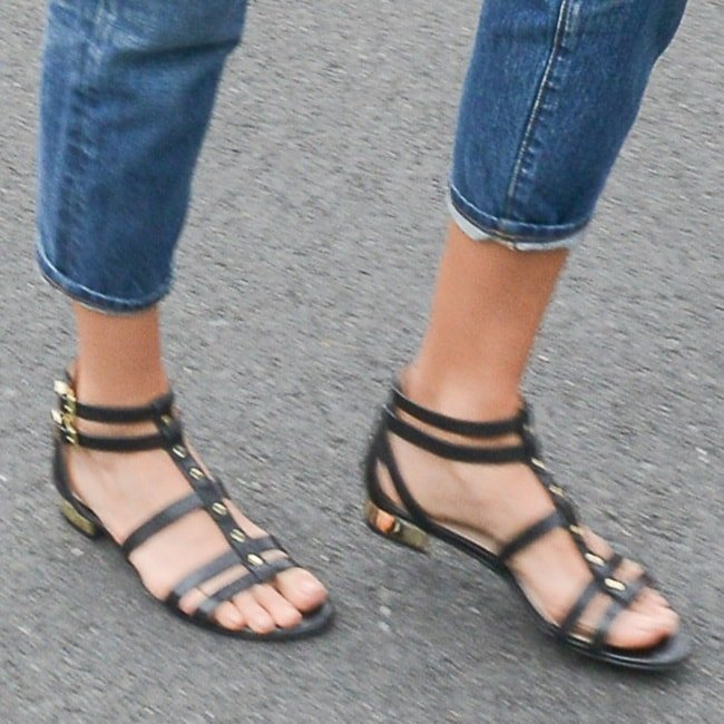 Jessica Alba wearing studded gold-detailed gladiator sandals