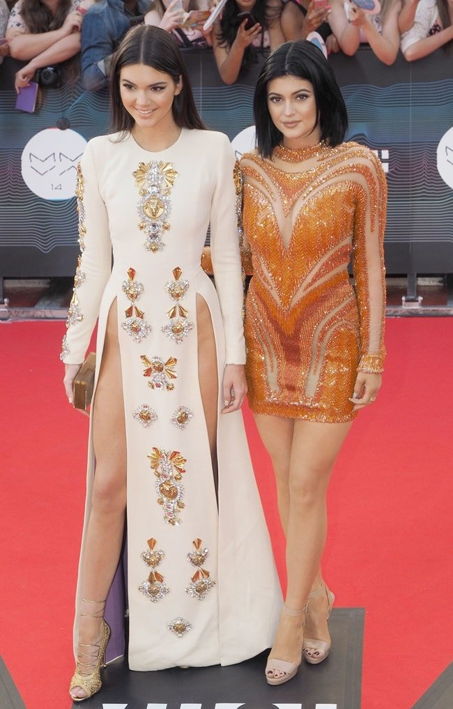 Kendall Jenner wearing a daring split-front dress and Kylie keeping it more demure in a sheer-paneled number during the 2014 MuchMusic Video Awards held in Toronto, Canada, on June 15, 2014