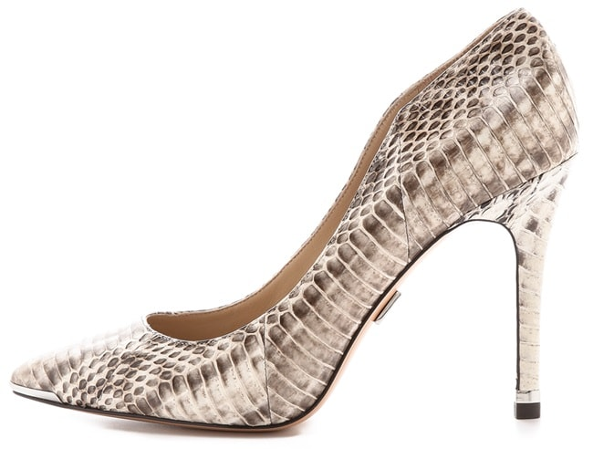 Slim, elegant Michael Kors Collection pumps make a daring impression in rich, speckled snakeskin