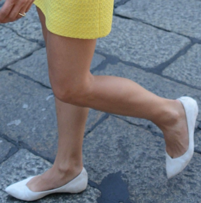 Michelle Hunziker decked in simple white flats and a textured yellow shift dress at Cafe Trussardi in Milan, Italy, on June 20, 2014