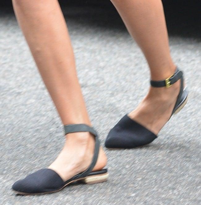 Nina Dobrev'spointy ankle-wrap flats