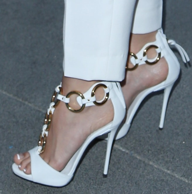 Ashley Tisdale wearing white gold-ring-detailed sandals