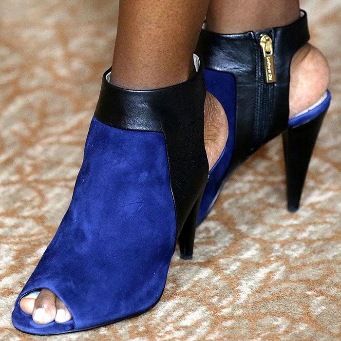 Aja Naomi King wearing blue suede peep toe booties