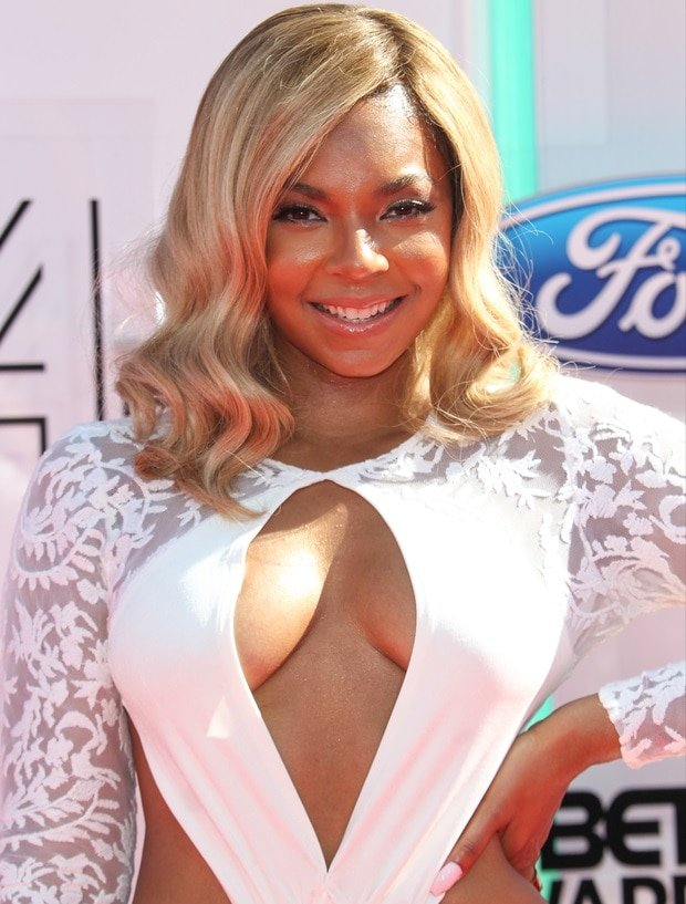 Ashanti in a white long-sleeved and lace-embellished dress from Michael Costello at the 2014 BET Awards held at the Nokia Theatre L.A. Live in Los Angeles, USA on June 29, 2014