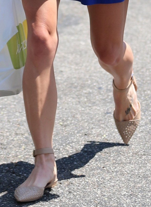 Ashley Greene's legs in nude flat shoes by Sam Edelman